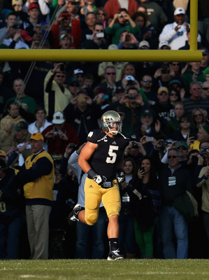 SOUTH BEND, IN - NOVEMBER 17: Manti T'eo #5 of the Notre Dame Fighting Irish runs onto the field as part of 'senior introductions' before a game against the Wake Forest Demon Deacons at Notre Dame Stadium on November 17, 2012 in South Bend, Indiana. (Phot