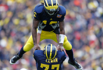 ANN ARBOR, MI - NOVEMBER 19: Denard Robinson #16 of the Michigan Wolverines celebrates a fourth quarter touchdown with Taylor Lewan #77 while playing the Nebraska Cornhuskers at Michigan Stadium on November 19, 2011 in Ann Arbor, Michigan. Michigan won th