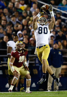 CHESTNUT HILL, MA - NOVEMBER 10: Tyler Eifert #80 of the Notre Dame Fighting Irish goes up to catch a pass against the Boston College Eagles during the game on November 10, 2012 at Alumni Stadium in Chestnut Hill, Massachusetts.  (Photo by Jared Wickerham