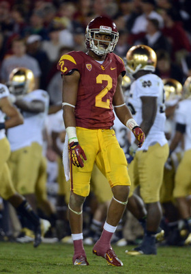 LOS ANGELES, CA - NOVEMBER 24:  Robert Woods #2 of the USC Trojans reacts after he is tackled off a punt during the second quarter to the Notre Dame Fighting Irish at Los Angeles Memorial Coliseum on November 24, 2012 in Los Angeles, California.  (Photo b