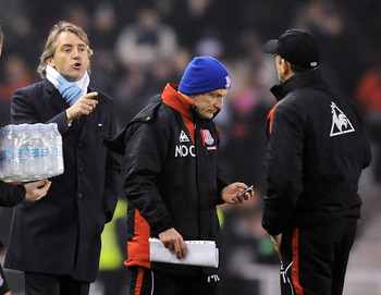 Roberto Mancini and Tony Pulis exchange words after a 2010 FA Cup tie between Manchester City and Stoke.