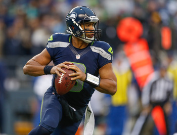 SEATTLE, WA - DECEMBER 30:  Quarterback Russell Wilson #3 of the Seattle Seahawks rolls out to pass against the St. Louis Rams at CenturyLink Field on December 30, 2012 in Seattle, Washington. The Seahawks defeated the Rams 20-13.  (Photo by Otto Greule J