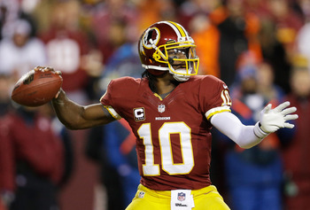 LANDOVER, MD - DECEMBER 30:   Robert Griffin III #10 of the Washington Redskins looks ot pass against the Dallas Cowboys in the second quarter at FedExField on December 30, 2012 in Landover, Maryland.  (Photo by Rob Carr/Getty Images)