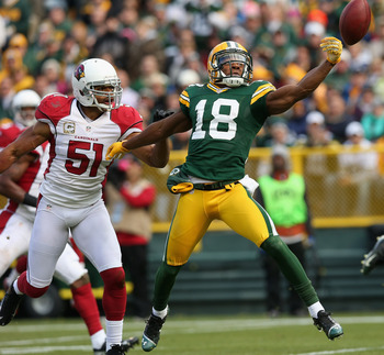 Paris Lenon (left) covers Randall Cobb of Green Bay in Week 9.