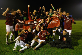 Hastings celebrating their qualification to the 3rd Round.