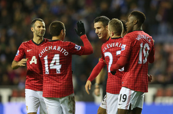 Manchester United players celebrate Robin van Persie's first goal in the win at Wigan.
