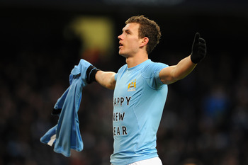 Edin Dzeko was booked for removing his shirt to reveal a 'Happy New Year' message.