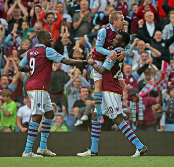 Aston Villa players and fans celebrate Christian Benteke's penalty strike at Swansea.