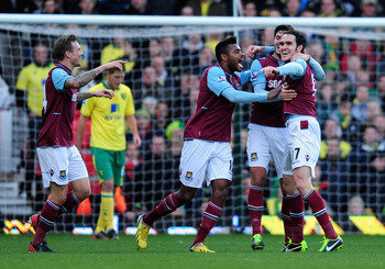 Joey O'Brien is mobbed by West Ham teammates after his winning goal against Norwich.
