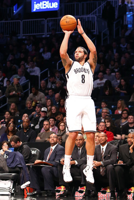 Dec. 29, 2012; Brooklyn, NY, USA; Brooklyn Nets point guard Deron Williams (8) shoots a three-pointer against the Cleveland Cavaliers during the second half at Barclays Center. Nets won 103-100. Mandatory Credit: Debby Wong-USA TODAY Sports