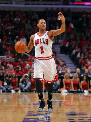 Apr 28, 2012; Chicago, IL, USA; Chicago Bulls point guard Derrick Rose (1) brings the ball down the court during the first quarter in the Eastern Conference quarterfinals of the 2012 NBA Playoffs against the Philadelphia 76ers at the United Center.  Manda