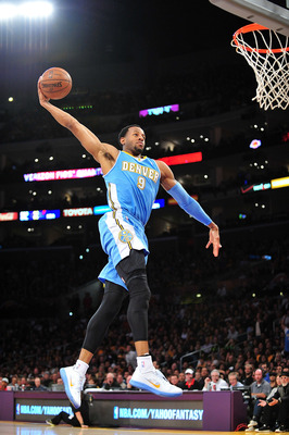 November 30, 2012; Los Angeles, CA, USA; Denver Nuggets shooting guard Andre Iguodala (9) goes in for a dunk but misses it against the Los Angeles Lakers during the first half at Staples Center. Mandatory Credit: Gary A. Vasquez-USA TODAY Sports