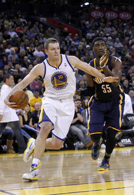 December 1, 2012; Oakland, CA, USA; Golden State Warriors forward David Lee (10) drives past Indiana Pacers center Roy Hibbert (55) during the second quarter at ORACLE Arena. Mandatory Credit: Cary Edmondson-USA TODAY Sports