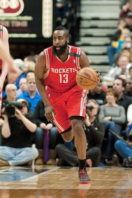 Dec 26, 2012; Minneapolis, MN, USA; Houston Rockets shooting guard James Harden (13) dribbles against the Minnesota Timberwolves during the first quarter at Target Center. Mandatory Credit:  Greg Smith-USA TODAY Sports