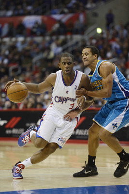Nov 26, 2012; Los Angeles, CA, USA; Los Angeles Clippers point guard Chris Paul (3) dribbles the ball against the New Orleans Hornets during the game at Staples Center. Mandatory Credit: Richard Mackson-USA TODAY Sports