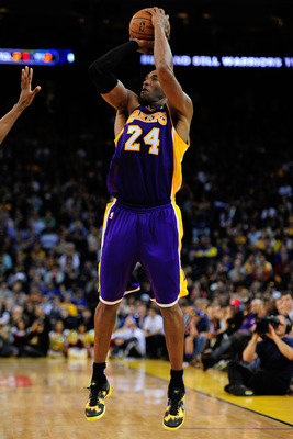 December 22, 2012; Oakland, CA, USA; Los Angeles Lakers shooting guard Kobe Bryant (24) shoots the ball during the fourth quarter against the Golden State Warriors at ORACLE Arena. The Lakers defeated the Warriors 118-115 in overtime. Mandatory Credit: Ky