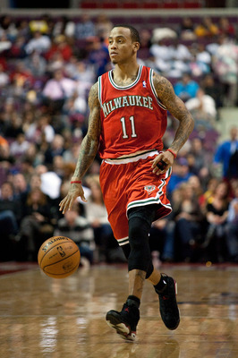 Dec 30, 2012; Auburn Hills, MI, USA; Milwaukee Bucks point guard Monta Ellis (11) brings the ball up court during the second quarter against the Detroit Pistons at The Palace. Mandatory Credit: Tim Fuller-USA TODAY Sports