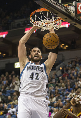Dec 7, 2012; Minneapolis, MN, USA; Minnesota Timberwolves power forward Kevin Love (42) dunks the ball in the first half against the Cleveland Cavaliers at Target Center. Mandatory Credit: Jesse Johnson-USA TODAY Sports