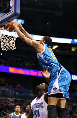 Dec 26, 2012; Orlando, FL, USA;  New Orleans Hornets power forward Anthony Davis (23) dunks the ball over Orlando Magic power forward Andrew Nicholson (44) during the first quarter at Amway Center. Mandatory Credit: Douglas Jones-USA TODAY Sports