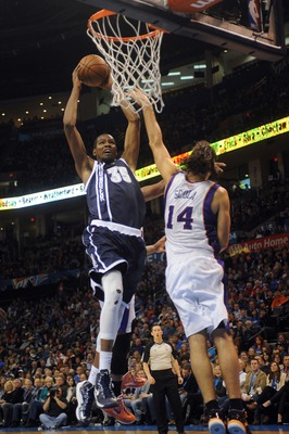 Dec 31, 2012; Oklahoma City, OK, USA; Oklahoma City Thunder forward Kevin Durant (35) attempts a shot against Phoenix Suns forward Luis Scola (14) during the second half at the Chesapeake Energy Arena.  Mandatory Credit: Mark D. Smith-USA TODAY Sports