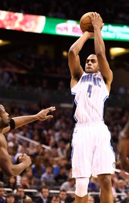 Dec 31, 2012; Orlando, FL, USA; Orlando Magic shooting guard Arron Afflalo (4) attempts a three point jump shot over Miami Heat shooting guard Dwyane Wade (3) during the fourth quarter at Amway Center. Miami defeated Orlando 112-110 in overtime. Mandatory