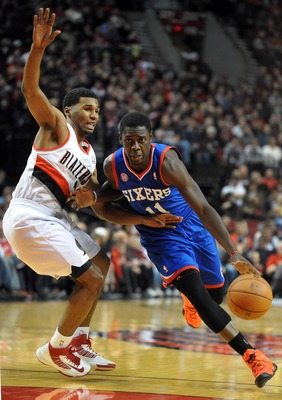 Dec. 29, 2012; Portland, OR, USA; Philadelphia 76ers point guard Jrue Holiday (11) drives to the basket past Portland Trail Blazers point guard Ronnie Price (24) during the first quarter of the game at the Rose Garden. Mandatory Credit: Steve Dykes-USA TO