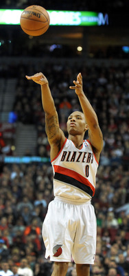 Dec. 29, 2012; Portland, OR, USA; Portland Trail Blazers point guard Damian Lillard (0) hits a three point shot during the fourth quarter of the game against the Philadelphia 76ers at the Rose Garden. The Blazers won the game 89-85. Mandatory Credit: Stev