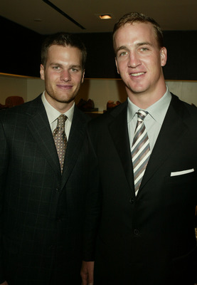 NEW YORK - APRIL13:  (L-R) NFL Quarterbacks Tom Brady and Peyton Manning attend the Ermenegildo Zegna Flagship store opening April 13, 2004 in New York City.  (Photo by Peter Kramer/Getty Images)