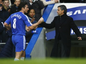 Jose Mourinho and Frank Lampard share a handshake during their Chelsea days together.