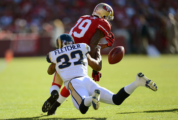 Ted Ginn loses the ball against the Rams.