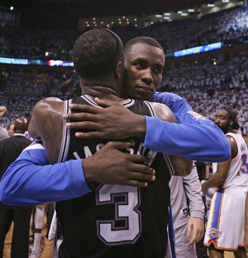 OKLAHOMA CITY, OK - JUNE 06:   Serge Ibaka #9 of the Oklahoma City Thunder hugs Stephen Jackson #3 of the San Antonio Spurs at the end of Game Six of the Western Conference Finals in the 2012 NBA Playoffs on June 6, 2012 at the Chesapeake Energy Arena in