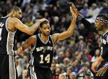 Nov. 10, 2012; Portland, OR, USA; San Antonio Spurs point guard Gary Neal (14) is congratulated by power forward Tim Duncan (21) and small forward Stephen Jackson (3) after hitting a shot during the fourth quarter of the game against the Portland Trail Bl