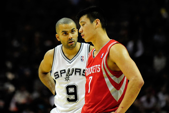 SAN ANTONIO, TX - DECEMBER 28: Jeremy Lin #7 of the Houston Rockets and Tony Parker #9 of the San Antonio Spurs have a brief conversation during a game at AT&T Center on December 28, 2012 in San Antonio, Texas. San Antonio won the game 122-116. NOTE TO US