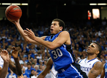 ATLANTA, GA - NOVEMBER 13:  Seth Curry #30 of the Duke Blue Devils drives past Julius Mays #34 of the Kentucky Wildcats during the 2012 State Farm Champions Classic at Georgia Dome on November 13, 2012 in Atlanta, Georgia.  (Photo by Kevin C. Cox/Getty Im