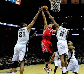 Tim Duncan going up for a block against the Rockets Jeremy Lin