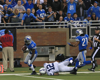 Andrew Luck attempts to make a tackle after throwing an interception during a Dec. 2 game against the Detroit Lions