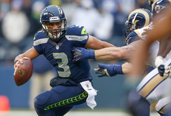 Russell Wilson tries to evade pressure during a Dec. 30 game against the St. Louis Rams
