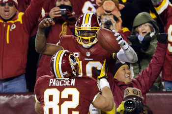 Robert Griffin III celebrates a touchdown with Logan Paulsen during a Dec. 30 game against the Dallas Cowboys