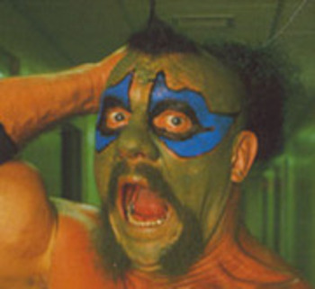 Dewey Robertson donned green and blue facepaint and a ridiculous hairstyle as the Missing Link in WWF. Photo Courtesy of oklafan.com