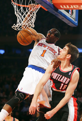 Stoudemire finishes a dunk over Portland's Victor Claver