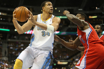October 25, 2012; Denver, CO, USA; Denver Nuggets center JaVale McGee (34) drives to the basket during the second half against the Los Angeles Clippers  at the Pepsi Center.  The Clippers won 106-94.  Mandatory Credit: Chris Humphreys-USA TODAY Sports