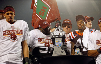 Look how excited Virginia Tech is to be holding the Russell Athletic Bowl trophy.