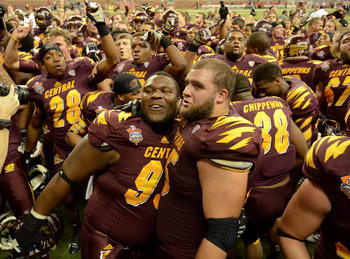 Central Michigan celebrating a Little Caesars Pizza Bowl win