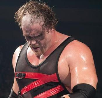 "Kane, like his ""brother"" Undertaker, has had his fair share of hairstyles throughout his career. He's yet to find a good one. Photo Courtesy of WWE.com"