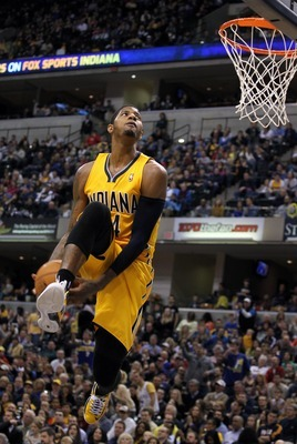 Dec 31 2012; Indianapolis, IN, USA; Indiana Pacers forward Paul George (24) goes up for a dunk against the Memphis Grizzlies at Bankers Life Fieldhouse. Indiana defeats Memphis 88-83. Mandatory Credit: Brian Spurlock-USA TODAY Sports