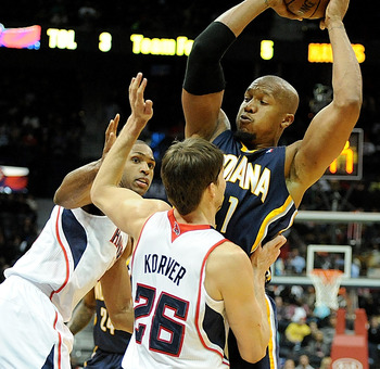 Dec 29, 2012; Atlanta, GA, USA; Atlanta Hawks center Al Horford (15) and shooting guard Kyle Korver (26) defend Indiana Pacers power forward David West (21) during the fourth quarter at Philips Arena. Mandatory Credit: Kevin Liles-USA TODAY Sports