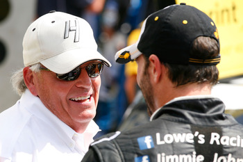INDIANAPOLIS, IN - JULY 29:  Team owner Rick Hendrick and Jimmie Johnson, driver of the #48 Lowe's/Kobalt Tools Chevrolet, celebrate after Johnson won the NASCAR Sprint Cup Series Crown Royal presents the Curtiss Shaver 400 at the Brickyard at Indianapoli