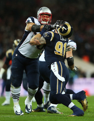 LONDON, ENGLAND - OCTOBER 28:   Sebastian Vollmer #76 of the New England Patriots tackles  Chris Long #91 of the St. Louis Rams during the NFL International Series match between the New England Patriots and the St. Louis Rams at Wembley Stadium on October