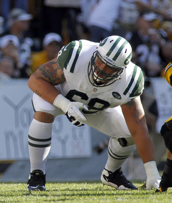 PITTSBURGH, PA - SEPTEMBER 16:  Matt Slauson #68 of the New York Jets blocks against the Pittsburgh Steelers during the game on September 16, 2012 at Heinz Field in Pittsburgh, Pennsylvania.  (Photo by Justin K. Aller/Getty Images)