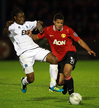 Zeki Fryers in action for Manchester United.